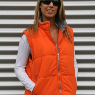 Winddichte oranje bodywarmer voor dames