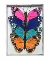 12x gekleurde vlinders op draad 9 cm decoratie trend