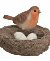 Decoratie vogelnest met gekleurde vogel en eitjes oranje trend