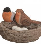 Decoratie vogelnest met gekleurde vogels en eitjes oranje trend