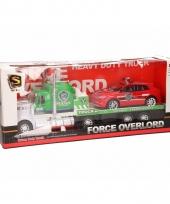 Groene politie vrachtauto met oplegger 52 cm trend