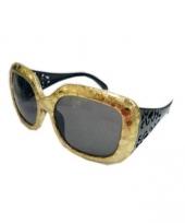 Grote zonnebril in het goud trend