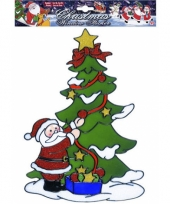 Kerst raamsticker kerstman bij kerstboom trend
