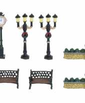 Kerstdorp decoratie lantaarns en hekjes trend