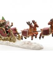 Kerstdorp figuurtjes kerstman in slee trend
