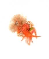 Oranje voetbal accesoire met bloemen trend