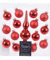 Rode glazen kerstballen en piek voor mini kerstboom trend