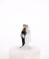 Trouwfiguurtje bruidspaar bloemen trend