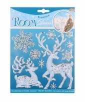Winterse raamdecoratie hert en sneeuwvlok trend