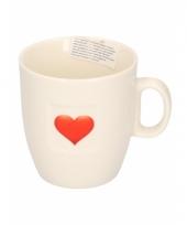 Witte koffiekop met hart trend