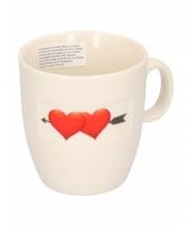 Witte koffiekop met harten trend